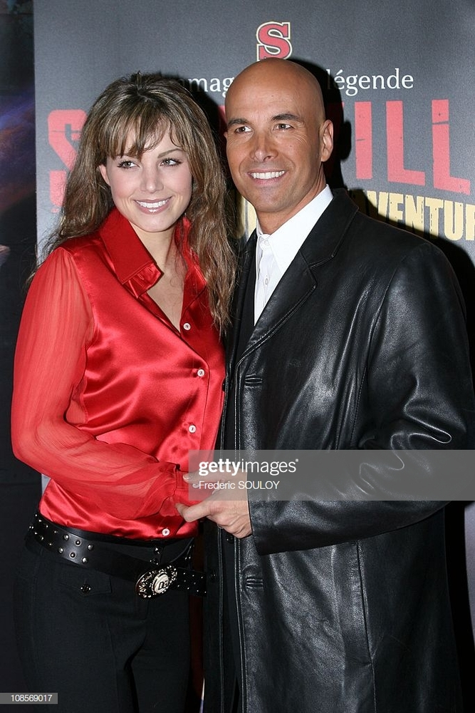 erica-durance-and-her-husband-in-paris-france-on-april-07-2005-picture-id108569017.jpg