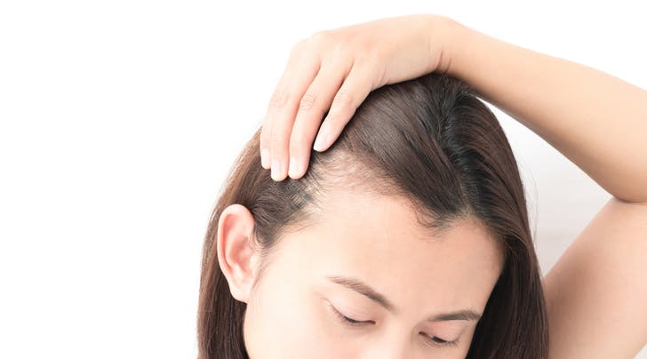 Woman_examining_hair_line.jpg